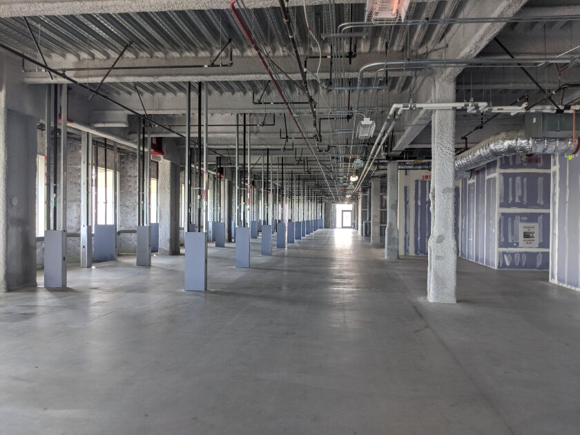 Palomar Medical Center's top two floors, which are vacant, have been selected to be used as a federal field hospital in anticipation of a surge of COVID-19 patients in the next few weeks. The Escondido hospital's 10th and 11th floors will house 250 beds, expected to arrive by mid-April.