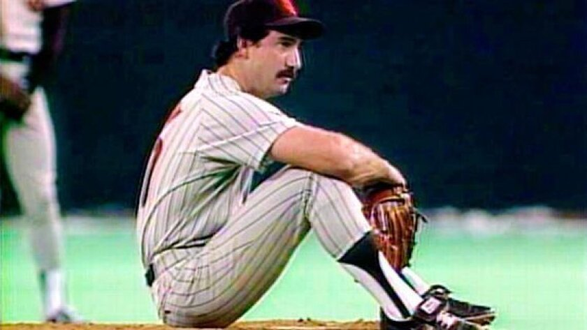 Padres pitcher Eric Show sat on the mound after giving up Pete Rose's record-breaking hit on Sept. 11, 1985.