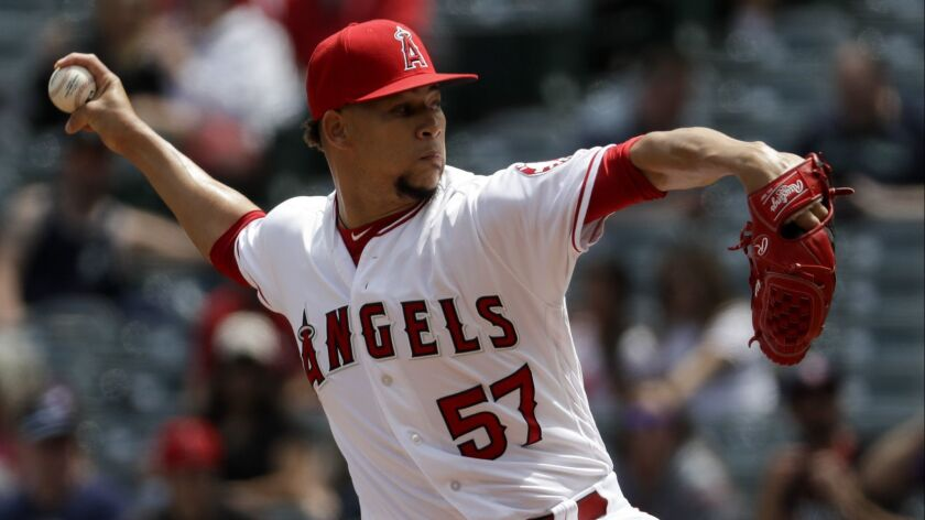 Los Angeles Angels relief pitcher Hansel Robles throws against the Seattle Mariners during the third