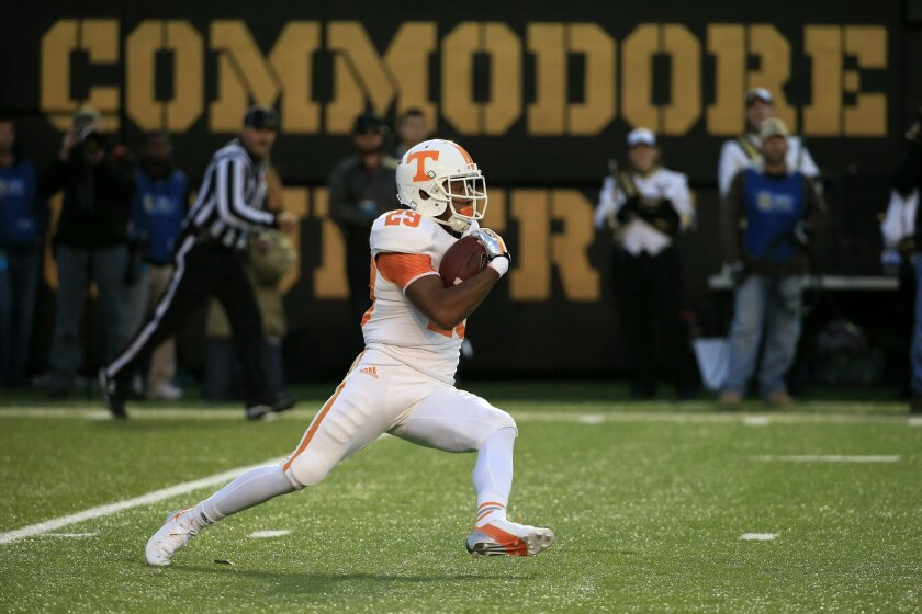 FILE - In this Nov. 29, 2014, file photo, Tennessee's Evan Berry returns a kick in the second quarter of an NCAA college football game against Vanderbilt, in Nashville, Tenn. As the nation's leading kickoff returner, the younger brother of Kansas City Chiefs defensive back and former Tennessee All-