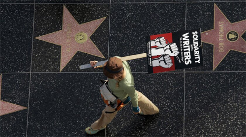 ALL OVER? Members of the Writers Guild of America vote today on ending their strike.