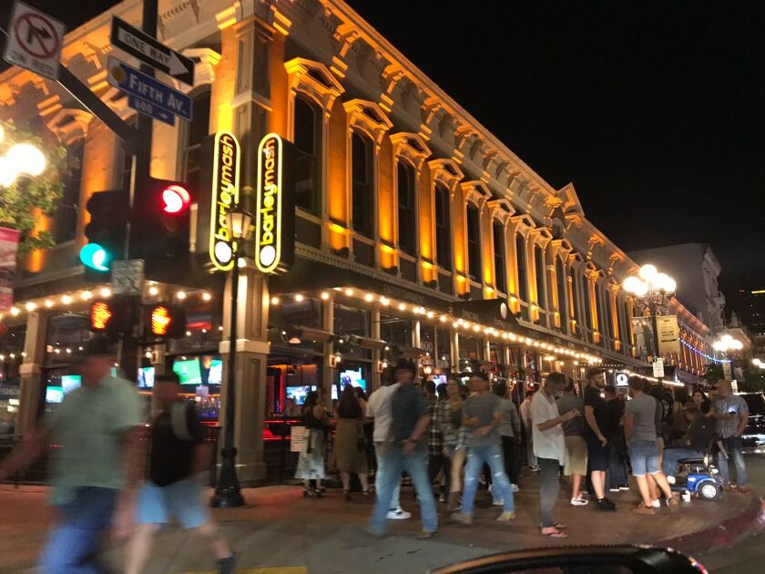 A crowd congregates in the Gaslamp Quarter Friday evening.