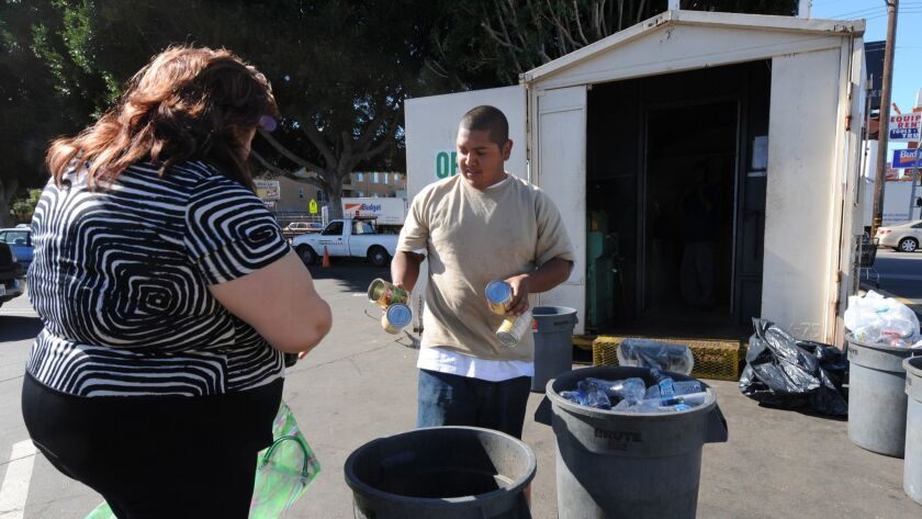 A woman delivers trash that she collected to a recycling center for payment in Santa Monica, Los Ang
