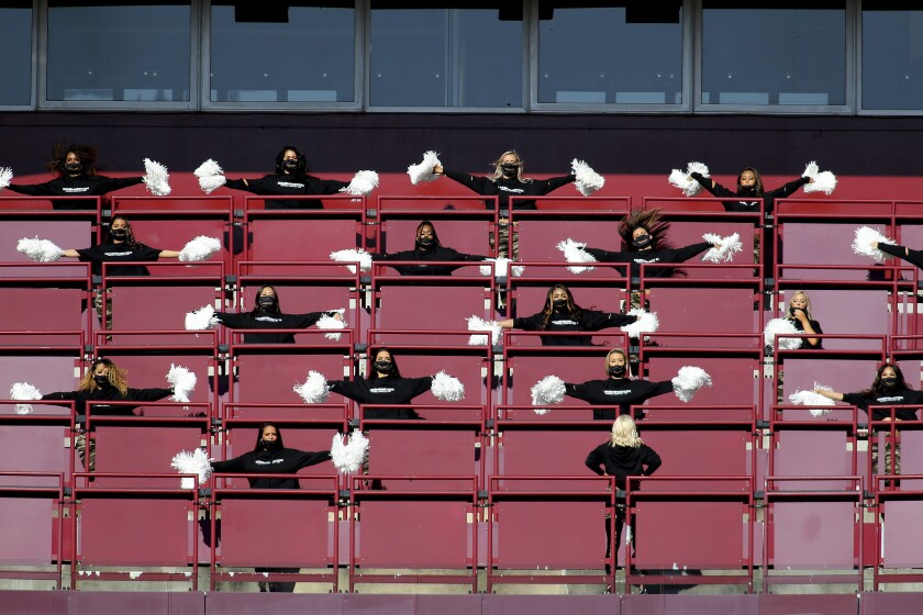 """FILE - Washington Football Team cheerleaders perform before an NFL football game against the New York Giants in Landover, Md., in this Sunday, Nov. 8, 2020, file photo. The Washington Football Team will not have cheerleaders for the 2021 season as part of an organizational rebranding. Washington hired Petra Pope, who managed the """"Laker Girls"""" and brings three decades of NBA experience as an adviser to take on the task of reinventing the group.(AP Photo/Daniel Kucin Jr., File)"""