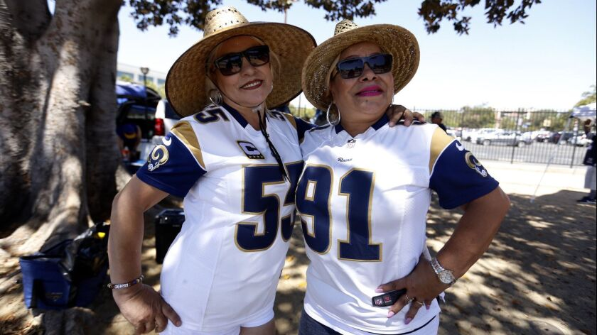 Two Rams fans from Whittier, CA celebrate before a game.