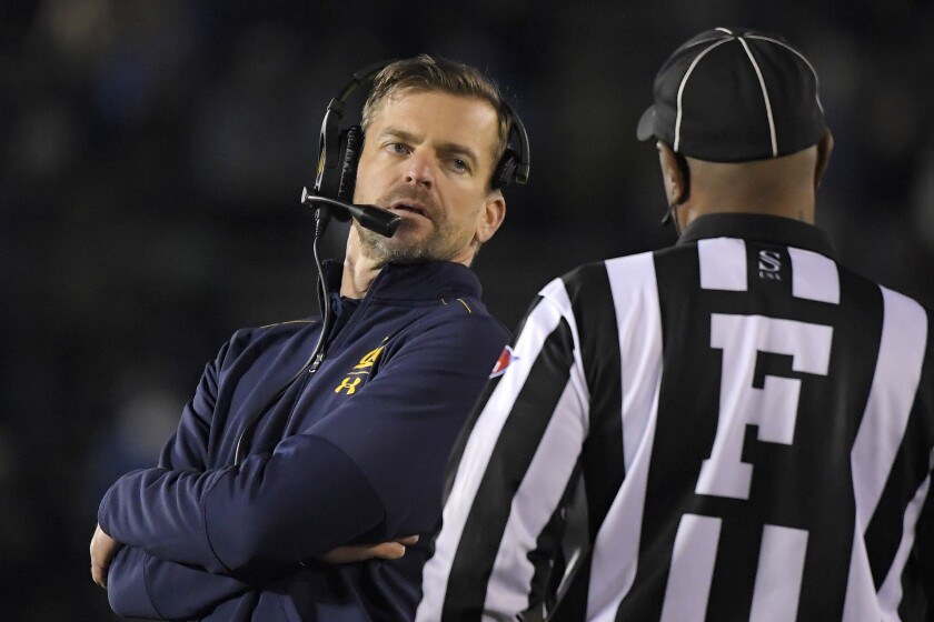 California coach Justin Wilcox talks to an official during a game against UCLA on Nov. 30, 2019, at the Rose Bowl.