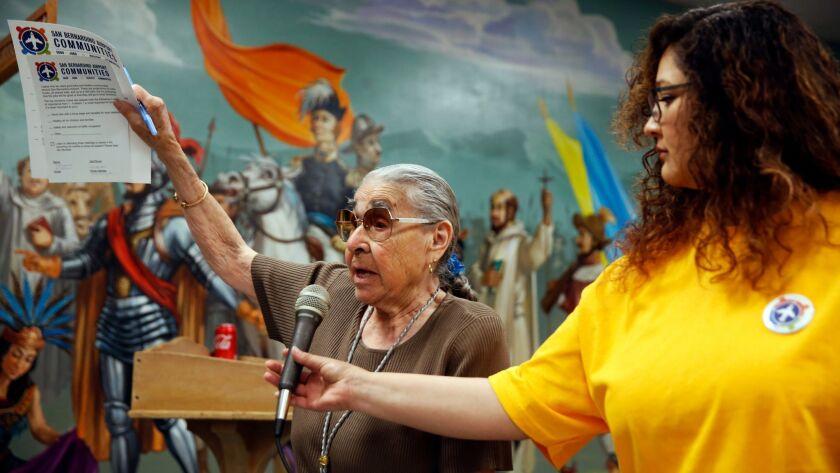 SAN BERNARDINO, CA-APRIL 17, 2019: Margaret B Cisneros, left, speaks at a town hall meeting at Our L