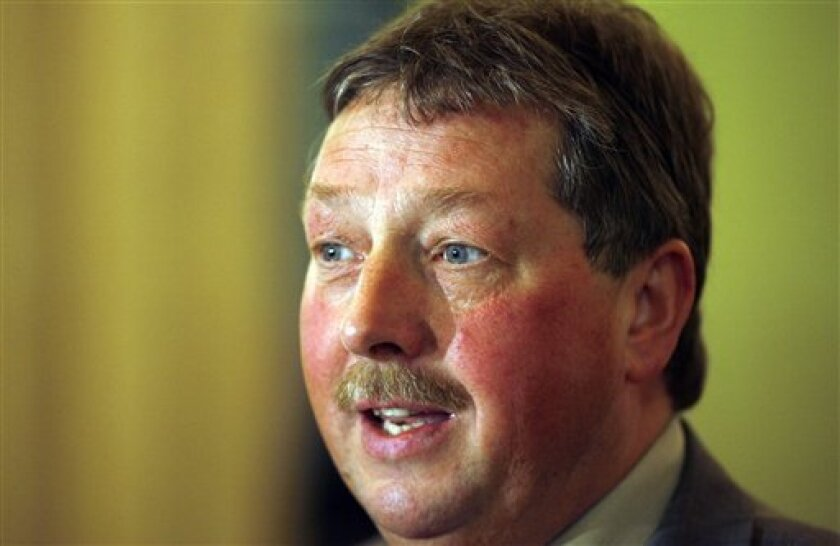 """Northern Ireland Environment Minister Sammy Wilson at Parliament Buildings, Belfast on Tuesday, Jan. 27, 2009. Northern Ireland's environment minister announced Monday Feb. 9, 2009, he has banned the local broadcast of British government ads on climate change and denounced their energy-saving message as """"insidious propaganda."""" (AP Photo/Peter Morrison, File)"""