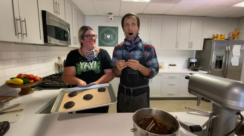 Vallie Gilley and Jason Mraz baking cookies at O'Side Kitchen Collaborative