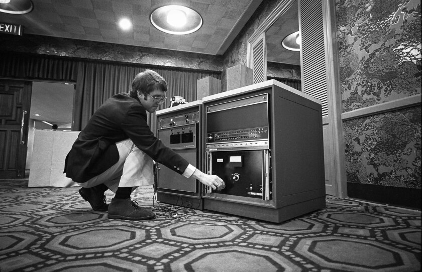 Aug. 23, 1976: Mike Grady, an engineer with Logicon Corp., adjusts the controls of a computer that understands human speech and responds with spoken words generated from 60 sounds.