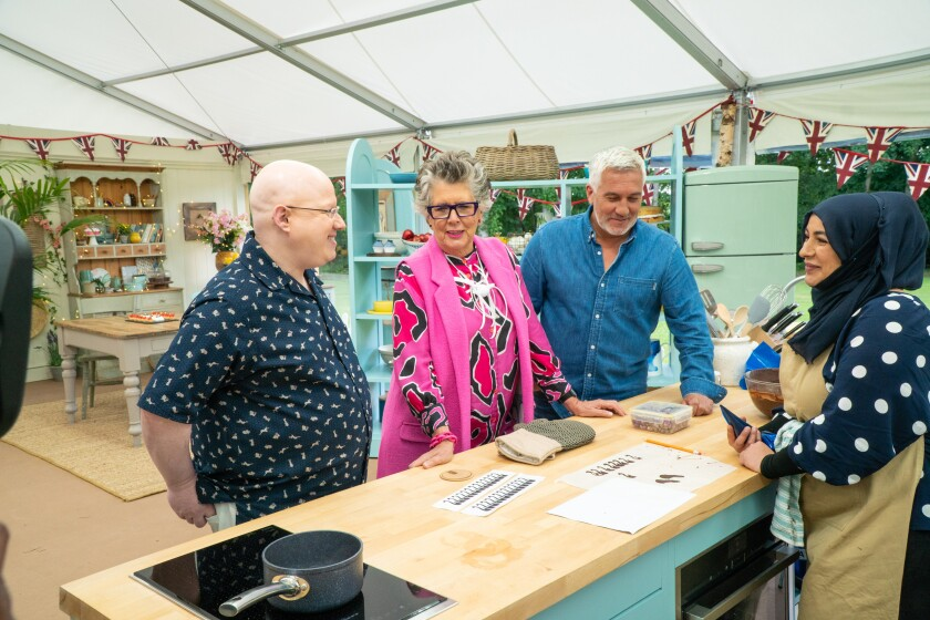 Contestant Sura, right, with host Matt Lucas, from left, and judges Prue Leith and Paul Hollywood.