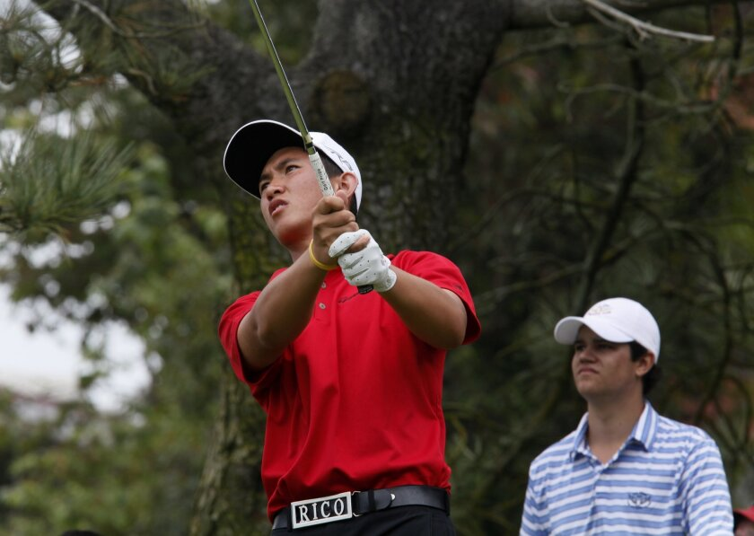 File photo of Rico Hoey playing in the 2012 Junior World championship that he won. Behind him is Beau Hossler.