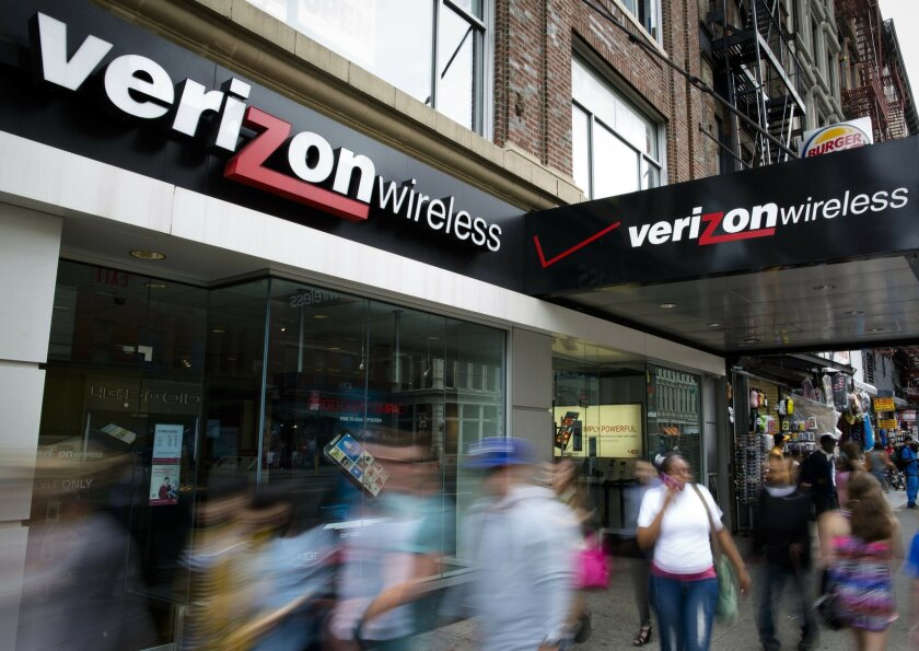 FILE - In this June 6, 2013, file photo, pedestrians pass a Verizon Wireless store on Canal Street in New York. Verizon announced Wednesday, July 6, 2016, that the company is hiking prices on its cellphone plans, though the new rates come with changes that might actually save you money. (AP Photo/J