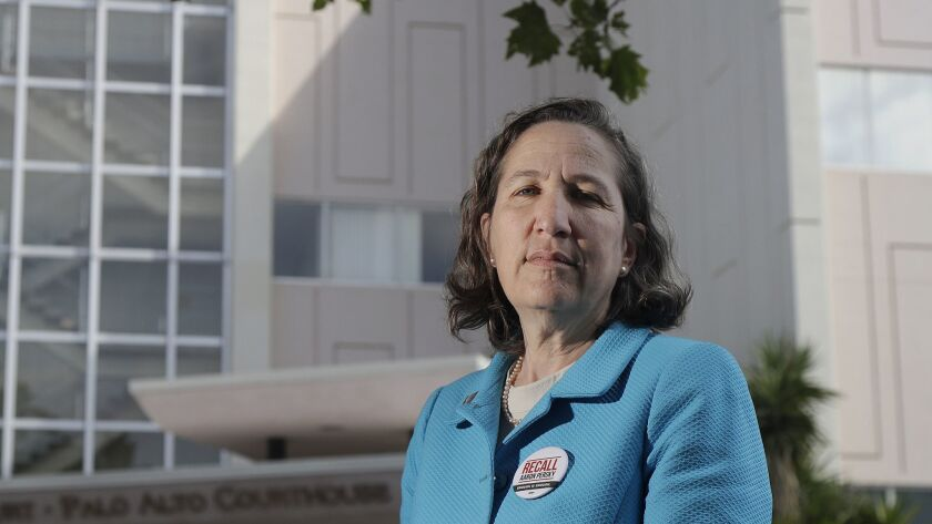 In this May 14, 2018 photo, Stanford law professor Michele Dauber poses for photos outside of the Pa