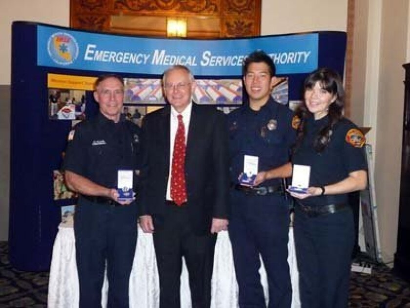 Paramedic Chris Olson poses with San Diego County EMS Director Dr. Bruce Haynes and EMT Kevin Riutzel of La Jolla and Paramedic Anne Marie Jensen at the awards presentation. Photo: Courtesy