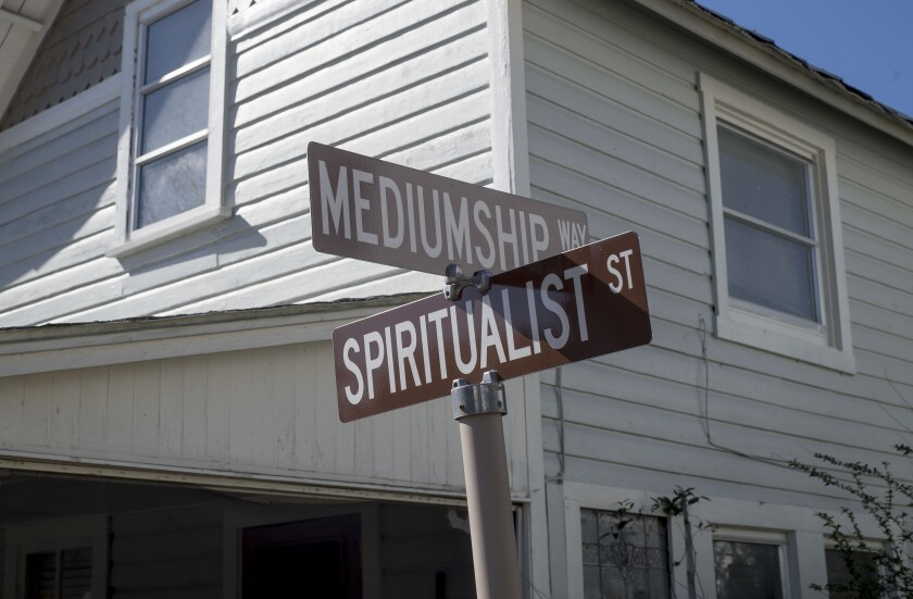 Road signs at the Cassadaga Spiritualist Camp in Cassadaga, Fla., read Mediumship Way and Spiritualist Street.