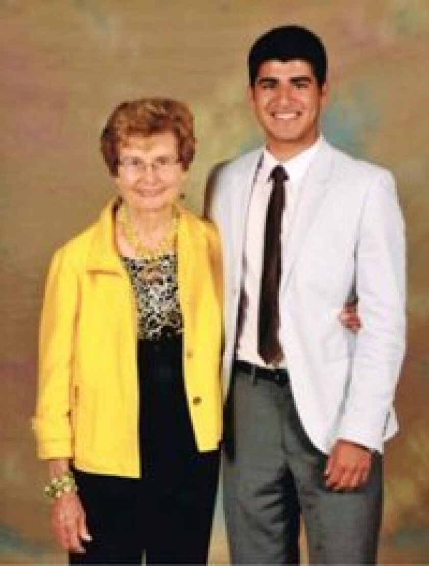 LaVerne Schlosser, chair of the Philanthropy Committee for the Rancho Santa Fe Garden Club, with scholarship recipient Enrique Aquino-Quiroz.