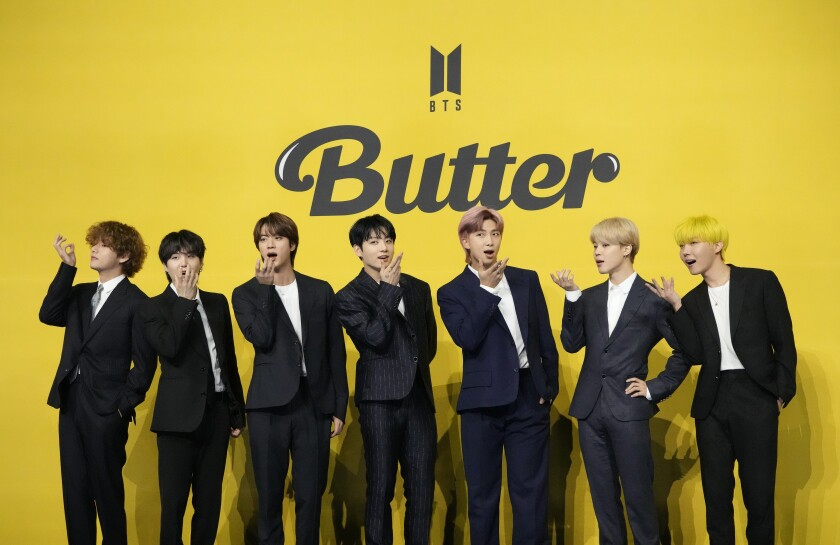 """FILE - In this May 21, 2021, file photo members of South Korean K-pop band BTS pose for photographers ahead of a press conference to introduce their new single """"Butter"""" in Seoul, South Korea. Chinese social media platform Weibo has banned a fan club of popular South Korean K-pop band BTS from posting for 60 days. Weibo said Sunday, Sept. 5, 2021, the club had raised funds illegally. The ban comes just days after photographs of a customized airplane funded by the fan club were posted online. (AP Photo/Lee Jin-man, File)"""
