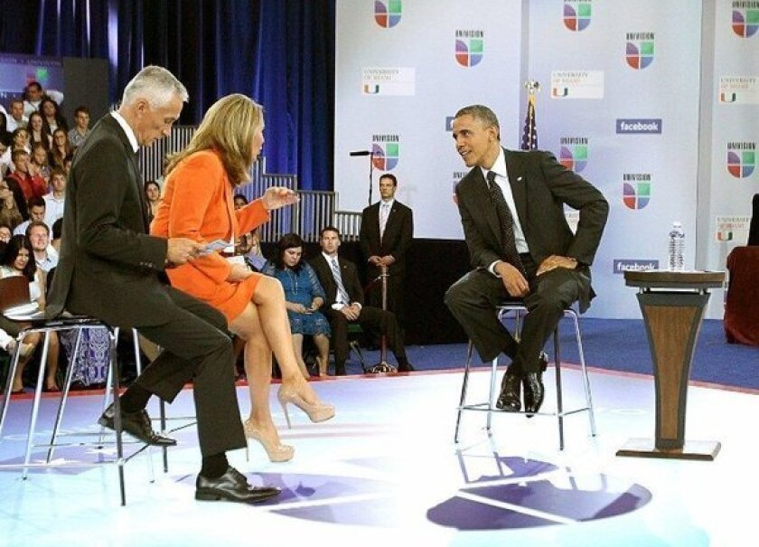 President Obama speaks with Jorge Ramos and Maria Elena Salinas at Univision's Meet the Candidates forum at the University of Miami in Coral Gables, Fla., on Thursday.