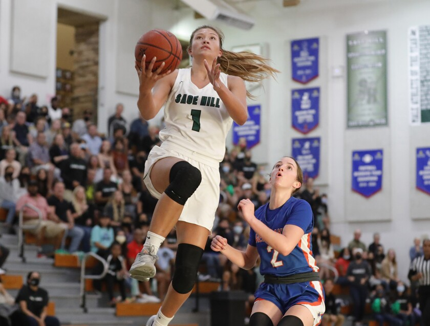 Emily Elliott drives into the lane for a layup during a CIF State Southern California Regional Division 2-A semifinal game.