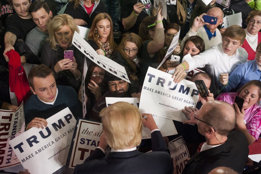 Donald Trump shakes hands and signs autographs with his supporters after speaking at a campaign rally at the Greater Columbus Convention Center in Ohio on Nov. 23.