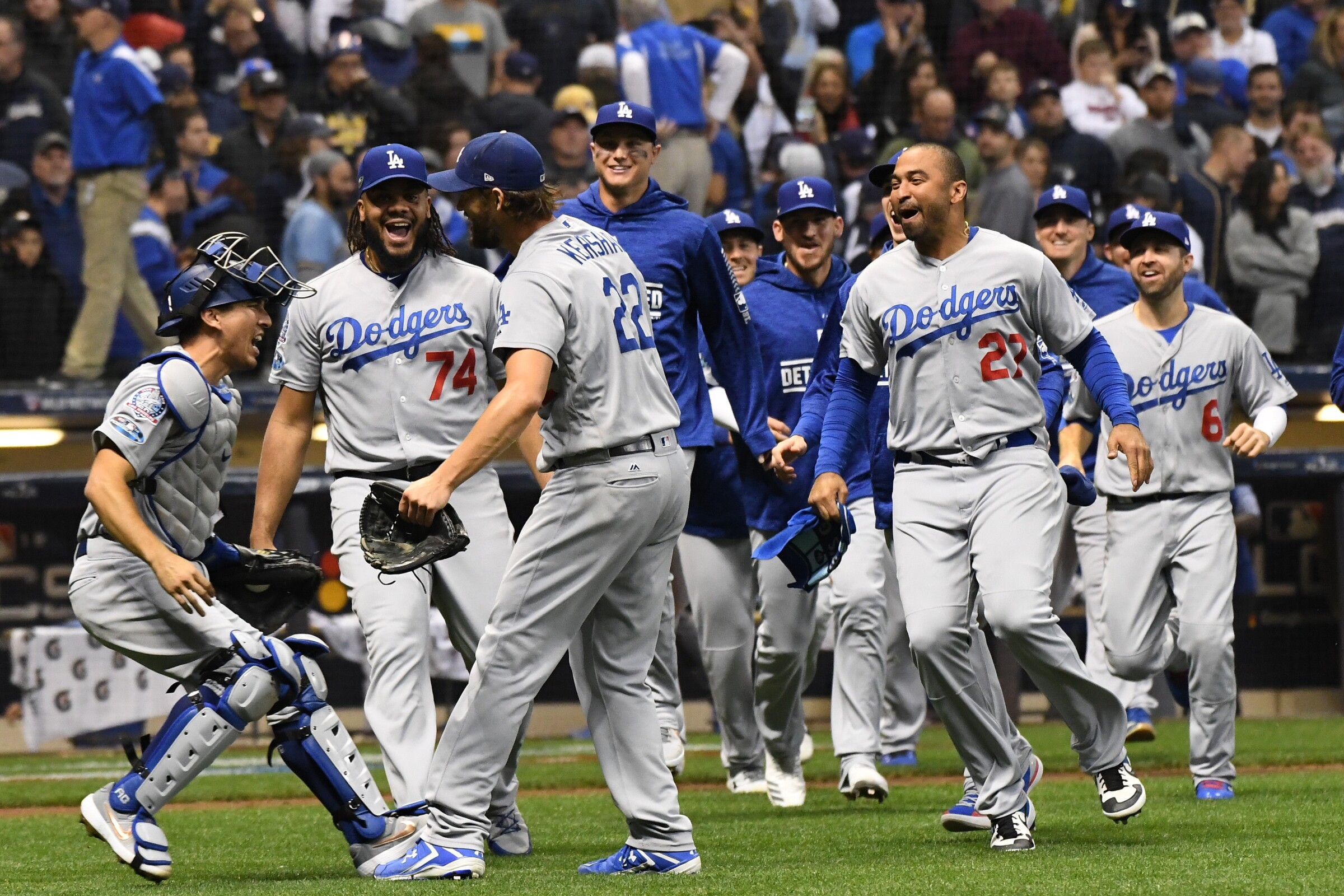 Dodgers teammates (from left) Austin Barnes, Kenley Jansen and Clayton Kershaw celebrate after winning the 2018 NLCS.