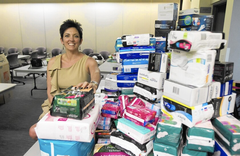 Gina Jackson helped collect more than a thousand feminine hygiene products for poor or unemployed women during a drive at a Tustin brewery.