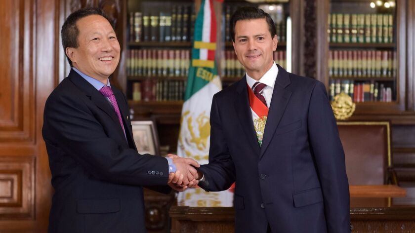 Mexican President Enrique Peña Nieto, right, greets North Korean Ambassador Kim Hyong Gil in Mexico City in June 2016.