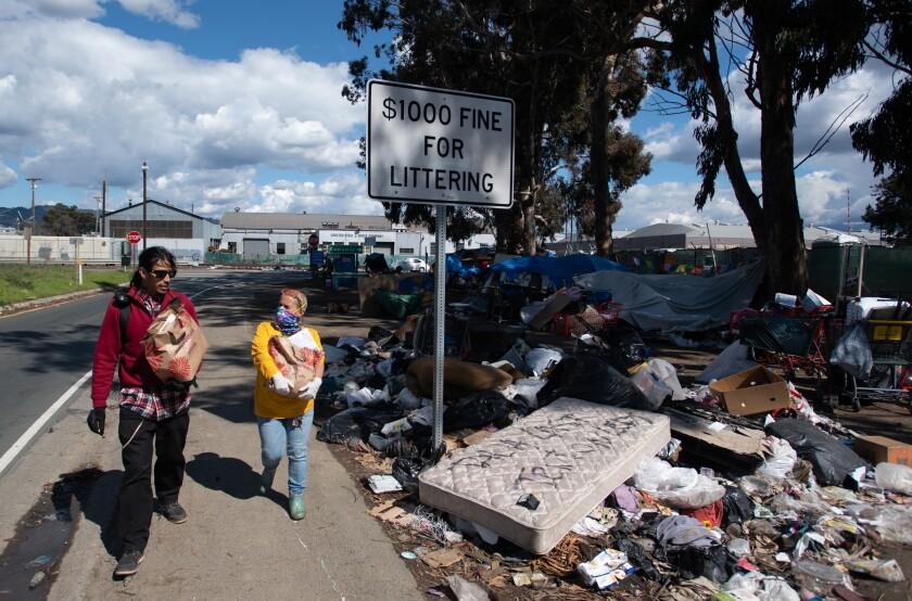 Homeless encampment along a freeway in Emeryville