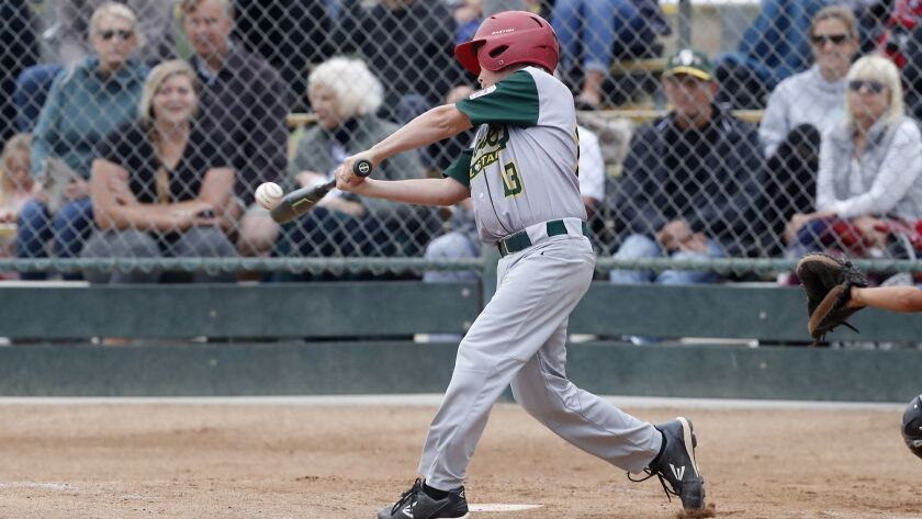 Seaview Little League's Joseph Rabay hits a two-run homer against Costa Mesa National in a Little Le