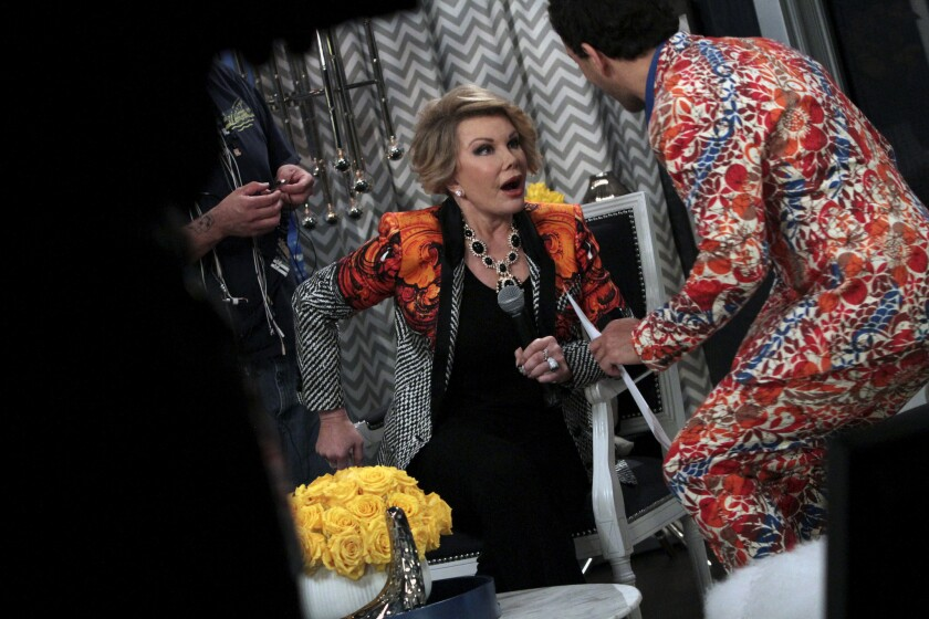 """Joan Rivers with with George Kotsiopoulos on the set of """"Fashion Police."""""""