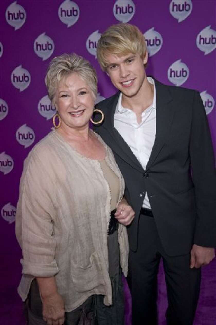 "President & CEO of The Hub, Margaret Loesch with ""Glee"" actor Chord Overstreet at The Hub TV Launch event in Los Angeles on Friday, October 1, 2010. (AP Photo/The Hub - Lisa Rose)"