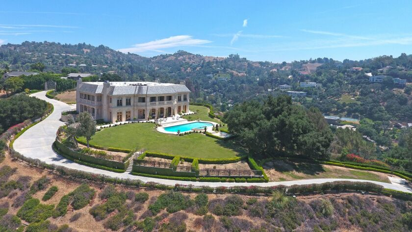 The French chateau-inspired home sits on more than five acres in Beverly Crest.