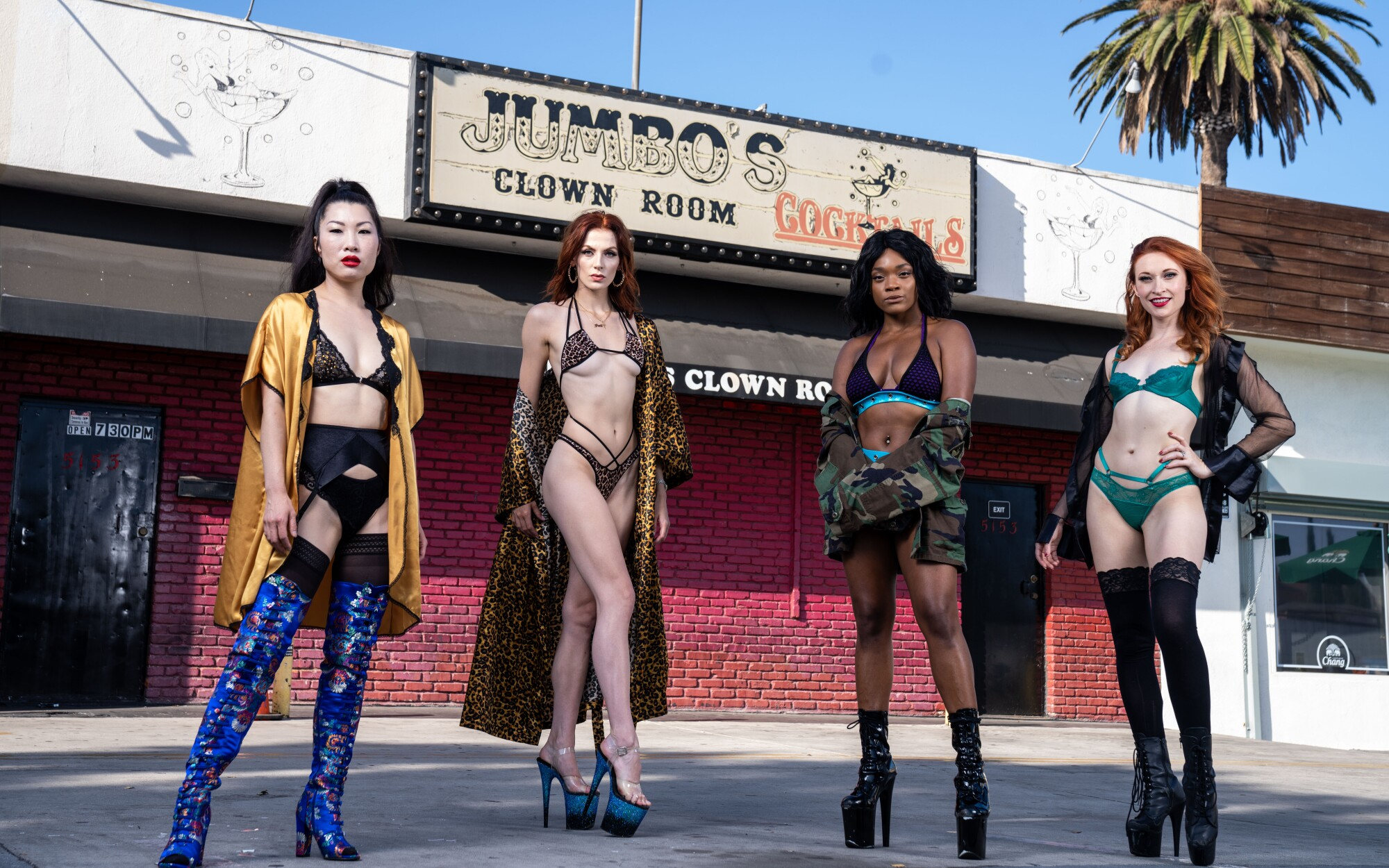 Coco Ono, left, Kitty, Danielle and Reagan in front of Jumbo's Clown Room. The women have moved their dancing online.