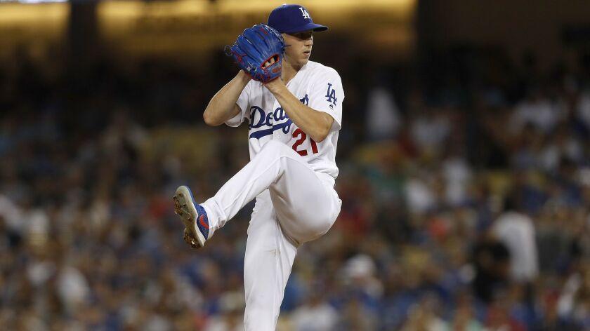LOS ANGELES, CALIF. - AUG. 22, 2018. Dodgers starter Walker Buehler delivers a pitch against the Ca
