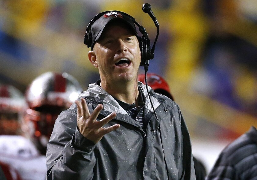 FILE - In this Oct. 24, 2015, file photo, Western Kentucky head coach Jeff Brohm gestures during the first half an NCAA college football game against LSU in Baton Rouge, La. Western Kentucky knows it will be tough trying to follow up a 12-win season that clinched Conference USA, a second straight b