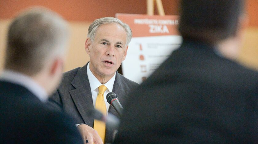 Gov. Greg Abbott speaks while hosting a Zika prevention roundtable with community leaders and health