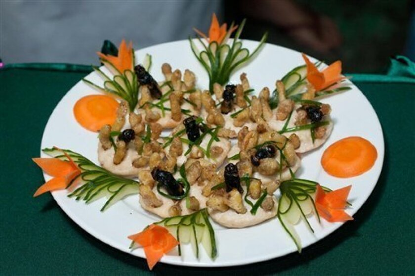 This undated photo provided by the United Nations Food and Agriculture Organization (FAO) shows a plate with insects during an insect cuisine competition at an unknown location in Laos. The U.N. has new weapons to fight hunger, boost nutrition and reduce pollution, and they might be crawling or flying near you right now: edible insects. The Food and Agriculture Organization on Monday, May 13, 2013, hailed the likes of grasshoppers, ants and other members of the insect world as an underutilized f
