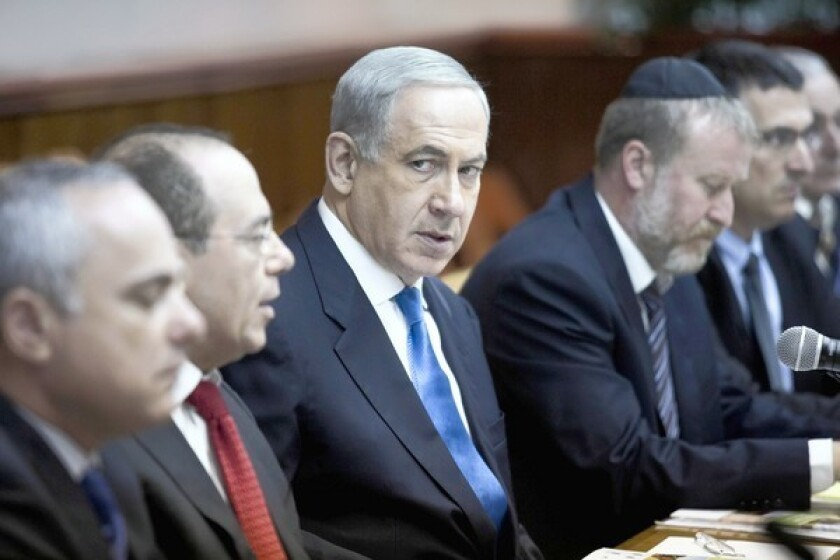 Israeli Prime Minister Benjamin Netanyahu, center, attends a Cabinet meeting in Jerusalem. He has refused to say whether Israel attacked the Syrian port city of Latakia and destroyed a cache of weapons.