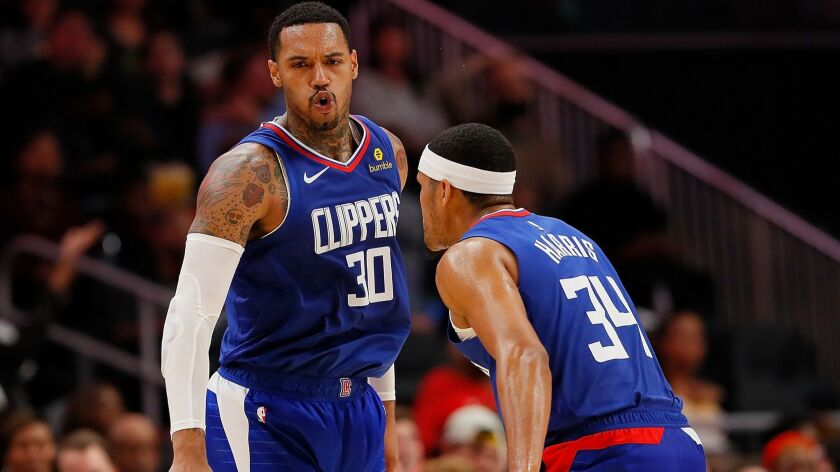 Clippers forwards Mike Scott (30) and Tobias Harris react after Scott made a three-point basket against the Hawks on Nov. 19 in Atlanta.