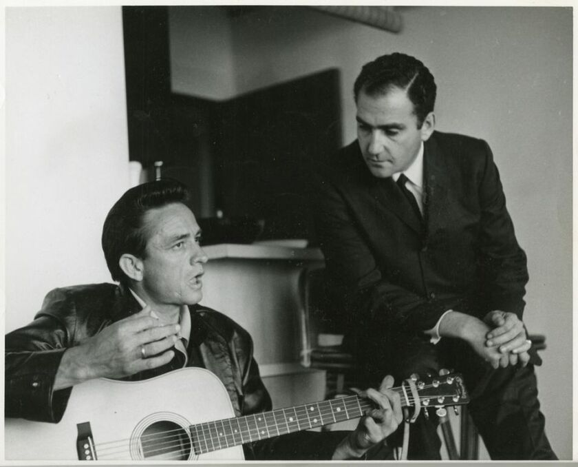 Johnny Cash and Saul Holiff in 1962.