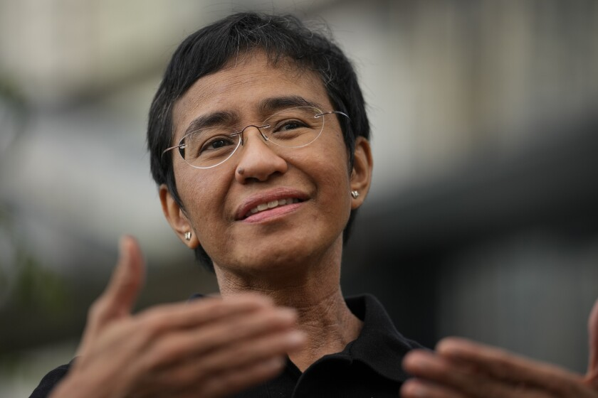 FILE - In this Oct. 9, 2021, file photo, Rappler CEO and Executive Editor Maria Ressa gestures during an interview at a restaurant in Taguig city, Philippines. Philippine President Rodrigo Duterte's administration belatedly congratulated journalist Ressa, Monday, Oct. 11, 2021, for being one of two winners of this year's Nobel Peace Prize for helping fight for freedom of expression under grave risks but rejected criticisms that it was a slap on his leadership, which critics say veer toward authoritarianism.(AP Photo/Aaron Favila, File)
