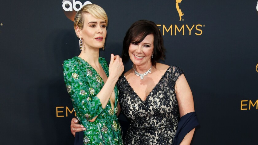 Sarah Paulson, left, and Marcia Clark on the red carpet before the Emmys ceremony in downtown L.A.