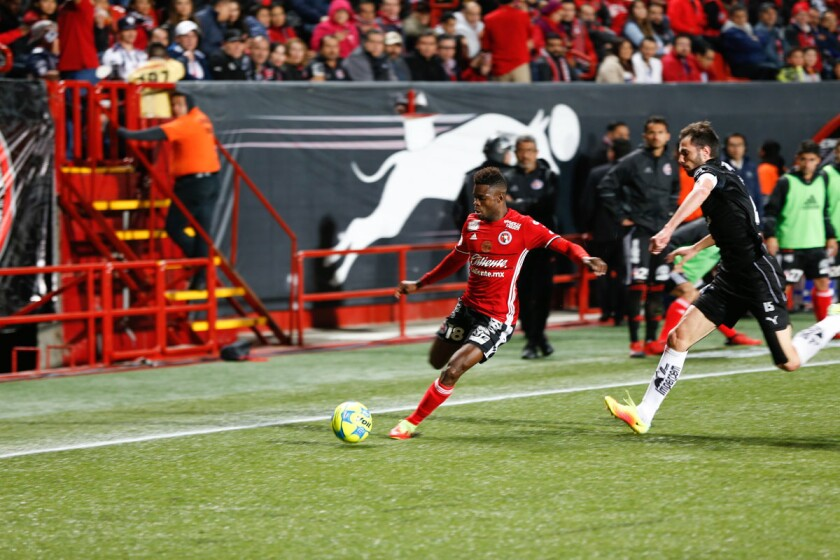 Mexican soccer teams Club Tijuana vs. Monterrey at Caliente Stadium. Final score 2-0 Tijuana. Tijuana's #7 Juan Lucero making a cross to center field. (Alejandro Tamayo/Union-Tribune)