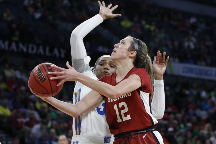 Stanford's Lexie Hull puts up a shot around UCLA's Lauryn Miller in their Pac-12 tournament semifinal game March 7, 2020, in Las Vegas.