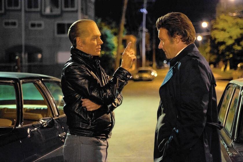 """Johnny Depp, left, as Whitey Bulger and Joel Edgerton as FBI Agent John Connolly in """"Black Mass"""""""