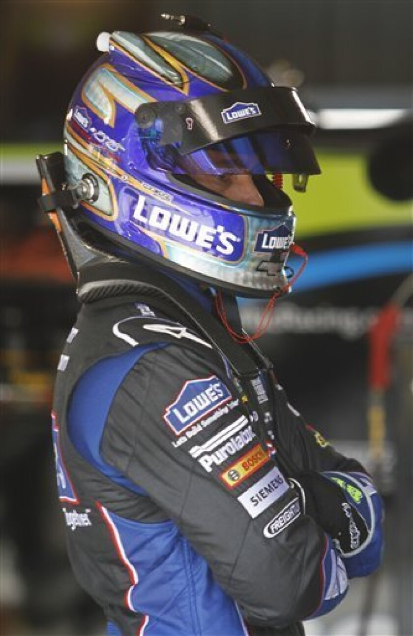 Driver Jimmie Johnson waits for his crew to finish his car during practice for Sunday's NASCAR Sprint Cup auto race at the Martinsville Speedway in Martinsville, Va., Friday, April 1, 2011. (AP Photo/Steve Helber)
