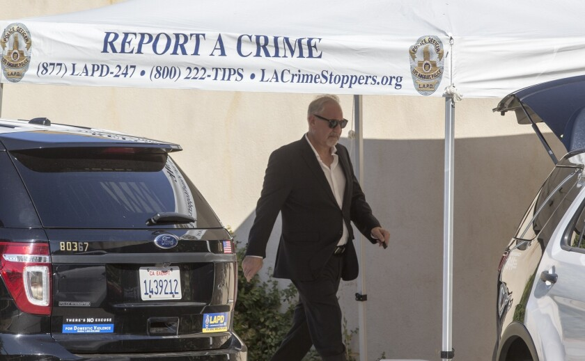 Singer Chris Brown's attorney Mark Geragos leaves Brown's Tarzana house Tuesday following a search by the Los Angeles Police Department.