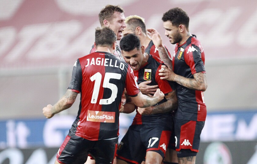 Genoa players celebrate after a goal during a serie A soccer match between Genoa and Verona, at the Luigi Ferraris stadium in Genoa, Italy, Sunday, Aug. 2, 2020. (Tano Pecoraro/Lapresse via AP)