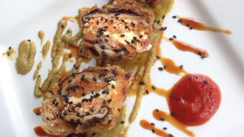 Sabuku Sushi's buku bites are a creative coming-together of shitake mushrooms, spicy tuna, spicy cra